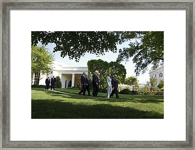 President Obama Walks With Members Framed Print