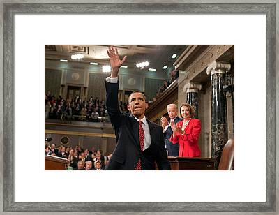 President Obama Waves To The First Lady Framed Print by Everett