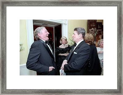 President Reagan Sharing A Joke Framed Print by Everett