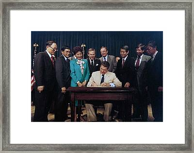 President Reagan Signs The Reparations Framed Print by Everett