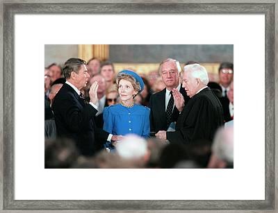 President Reagan Taking The Oath Framed Print by Everett