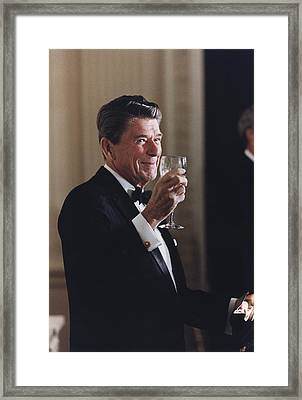 President Reagan Toasting At A State Framed Print by Everett