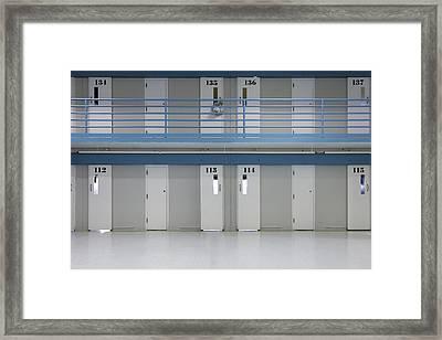 Prison Cells On Two Floors. Doors Framed Print by Roberto Westbrook