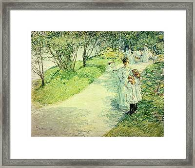 Promenaders In The Garden Framed Print by Childe Hassam