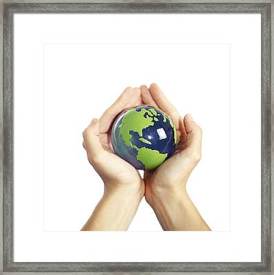 Protected Earth, Conceptual Image Framed Print by Cristina Pedrazzini