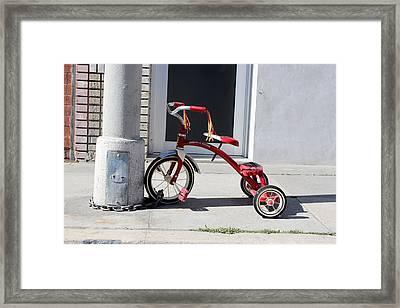 Protecting The Wheelz Framed Print by Robert Sebolt