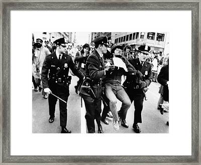 Protester Arrested At President Richard Framed Print by Everett
