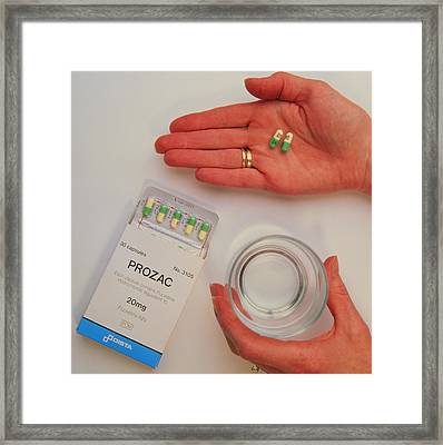 Prozac Pack With Pills In Hand And Glass Of Water Framed Print by Damien Lovegrove