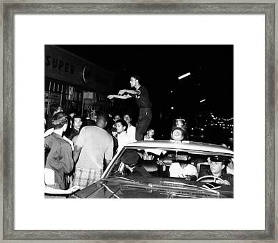 Puerto Rican Youth Standing On A Police Framed Print by Everett