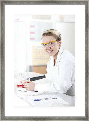 Pupil In A Science Lesson Framed Print by