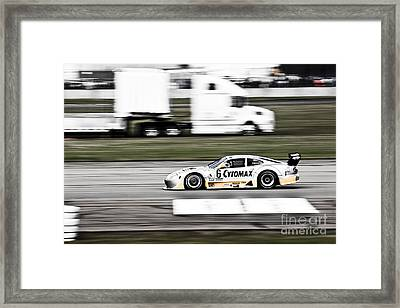 Racing By Framed Print by Darcy Michaelchuk