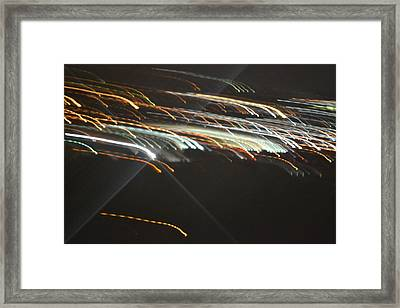Racing Light Framed Print by Naomi Berhane