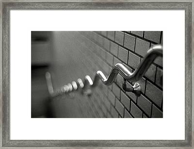 Railing On Wall Framed Print by Colin Barey