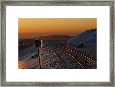 Railroad Tracks At Sunset In An Icy Framed Print