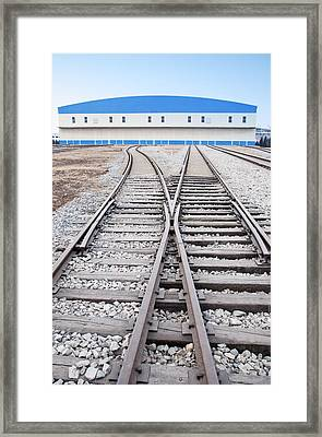 Railway Shed And Sidings. Bright Blue Framed Print