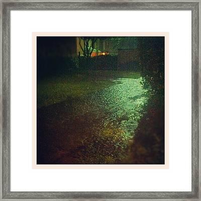 Rain Flooding The Sidewalk At Night Framed Print