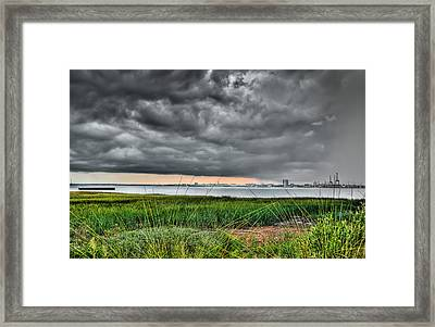 Rain Rolling In On The River Framed Print