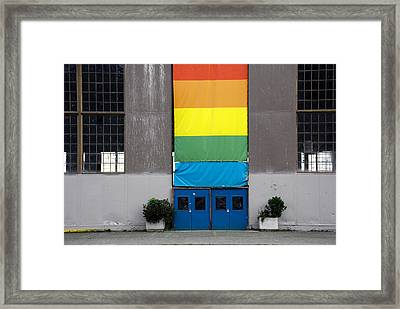 Framed Print featuring the photograph Rainbow Banner Building by Kathleen Grace