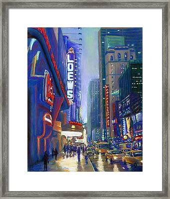 Rainy Reflections In Times Square Framed Print by Li Newton