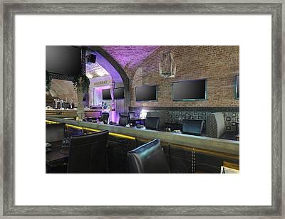Raw Of Tv Screens On Restaurant Wall Framed Print by Magomed Magomedagaev