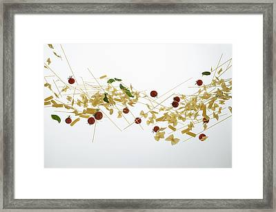 Raw Pasta, Tomatoes, And Basil Against A White Background Framed Print by Dual Dual