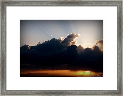 Rays Of Light Over Mount Taylor Framed Print by Aaron Burrows