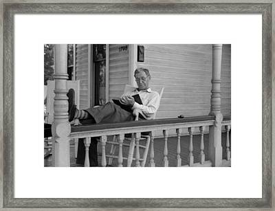 Reading A Good Book. Middle Age Man Framed Print by Everett