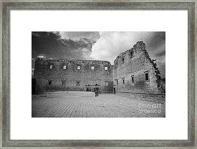 Rear Walls Of The Old Palazzo Del Provedittore Royal Palace Entrance In The Old Town Of Famagusta Framed Print by Joe Fox