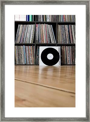 Records Leaning Against Shelves Framed Print