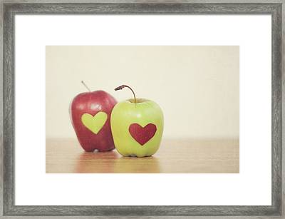 Red And Green Apple With Heart Shape Framed Print by Maria Kallin