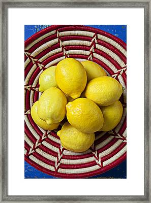 Red And White Basket Full Of Lemons Framed Print by Garry Gay