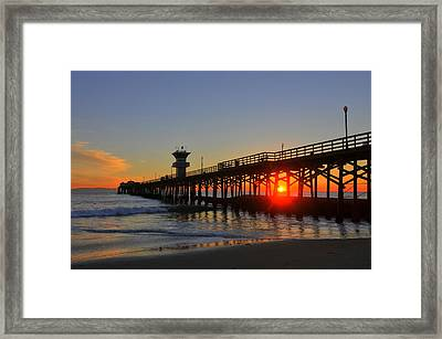 Red Ball Behind Pylons Framed Print
