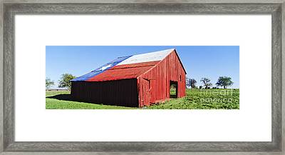 Red Barn In Field With Texas Flag On Roof Framed Print by Jeremy Woodhouse