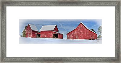 Red Barns In The Snow Framed Print