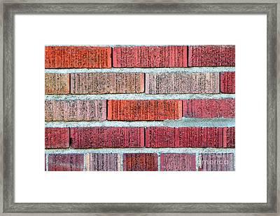 Red Brick Wall Framed Print by Henrik Lehnerer