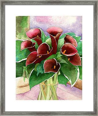 Red Calla Lilies Framed Print by Eunice Olson