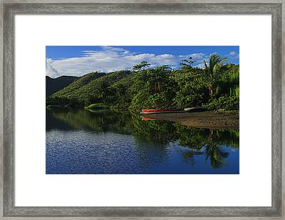 Red Canoe On Roseau River- St Lucia Framed Print by Chester Williams