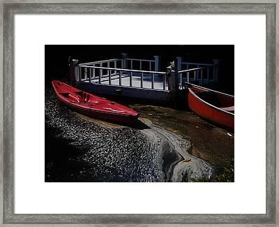Red Canoes Framed Print