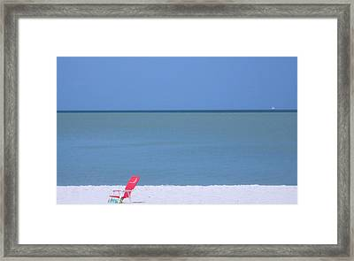 Red Chair And Sailboat Framed Print