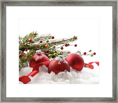 Red Christmas Balls In The Snow  Framed Print by Sandra Cunningham