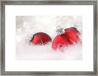 Red Christmas Balls In White Feathers  Framed Print by Sandra Cunningham