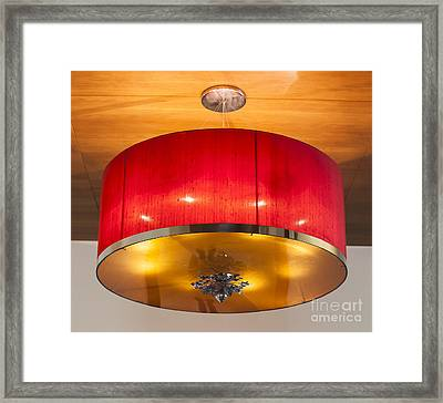 Red Circles Chandelier  Framed Print by Chavalit Kamolthamanon