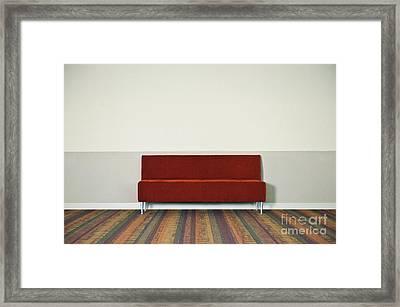 Red Couch Against Wall Framed Print by Dave & Les Jacobs