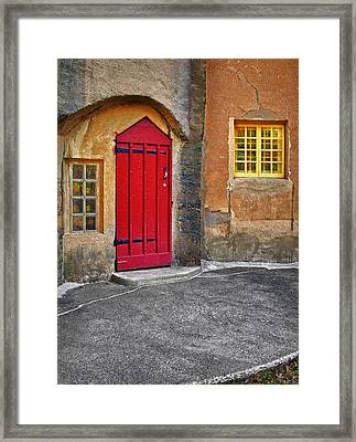 Red Door And Yellow Windows Framed Print by Susan Candelario