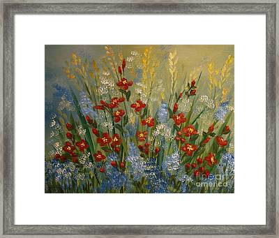 Red Flowers In The Garden Framed Print