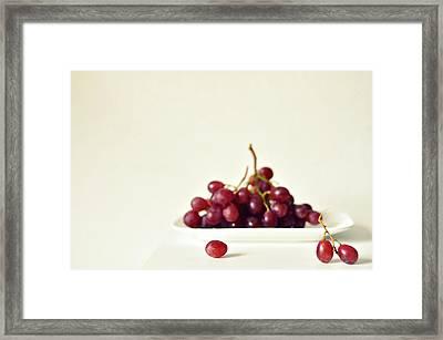 Red Grapes On White Plate Framed Print by Photo by Ira Heuvelman-Dobrolyubova