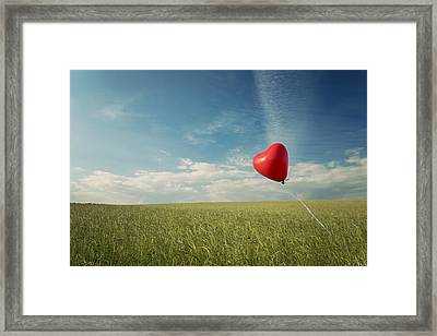 Red Heart Balloon, Blue Sky And Fields Framed Print by Image by Debbie Margetts - Ancora Imparo