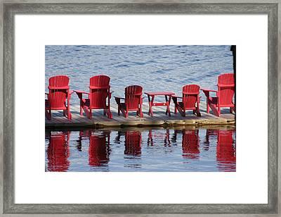 Red Muskoka Chairs Framed Print by Carolyn Reinhart