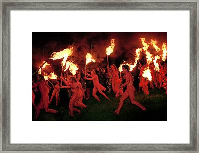 Red-painted Revelers Framed Print by Jim Richardson