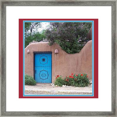Red Poppies Blue Door Framed Print by Susan Alvaro